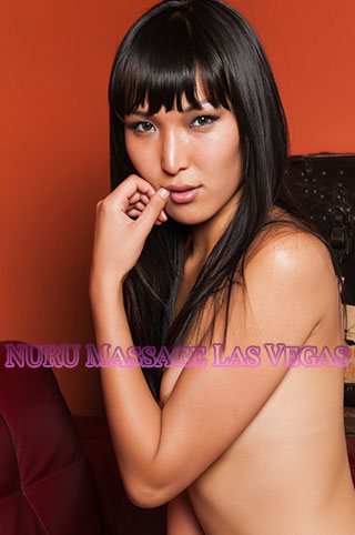 Asian massage Las Vegas offered by cute Asian girl who poses topless for the camera.