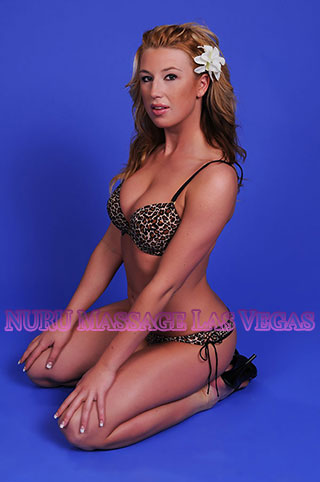 Couples massage Las Vegas offered by ginger haired girl who looks like a pinup model.